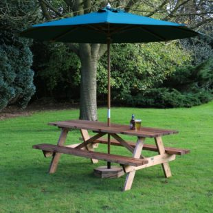 A 2m long wooden A frame picnic table located on a lawn with a green parasol