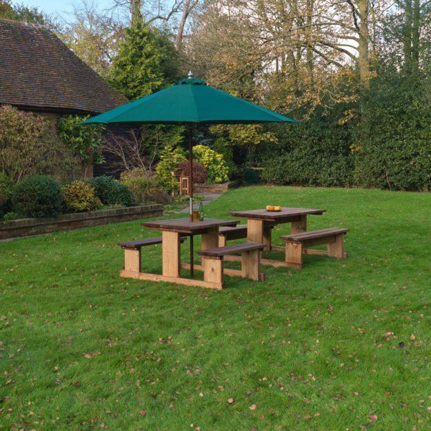 Two Bourton 2 seater picnic tables in a pub garden
