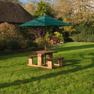 A solidly built wooden picnic table suitable for 4 people with rectangular table and two fixed benches