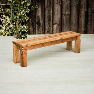 A chunky wooden outdoor backless bench seat