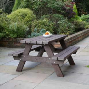 A brown a frame picnic table made from recycled plastic lumber located on a patio