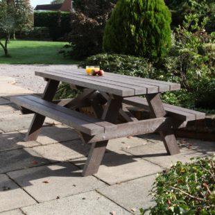 A 1.8m long A Frame picnic table made from recycled plastic located on a patio