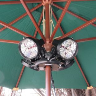 Heatmaster patio heater which is 4 heat lamps attached underneath a patio parasol to heat the outdoor area beneath it