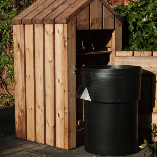 A wooden litterbin with front door open showing black plastic bin inside