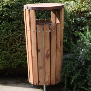 A cylindrical wooden rubbish bin with a flat lid and side openings