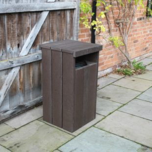 A chunky brown recycled plastic litterbin with a side slot and flat top.