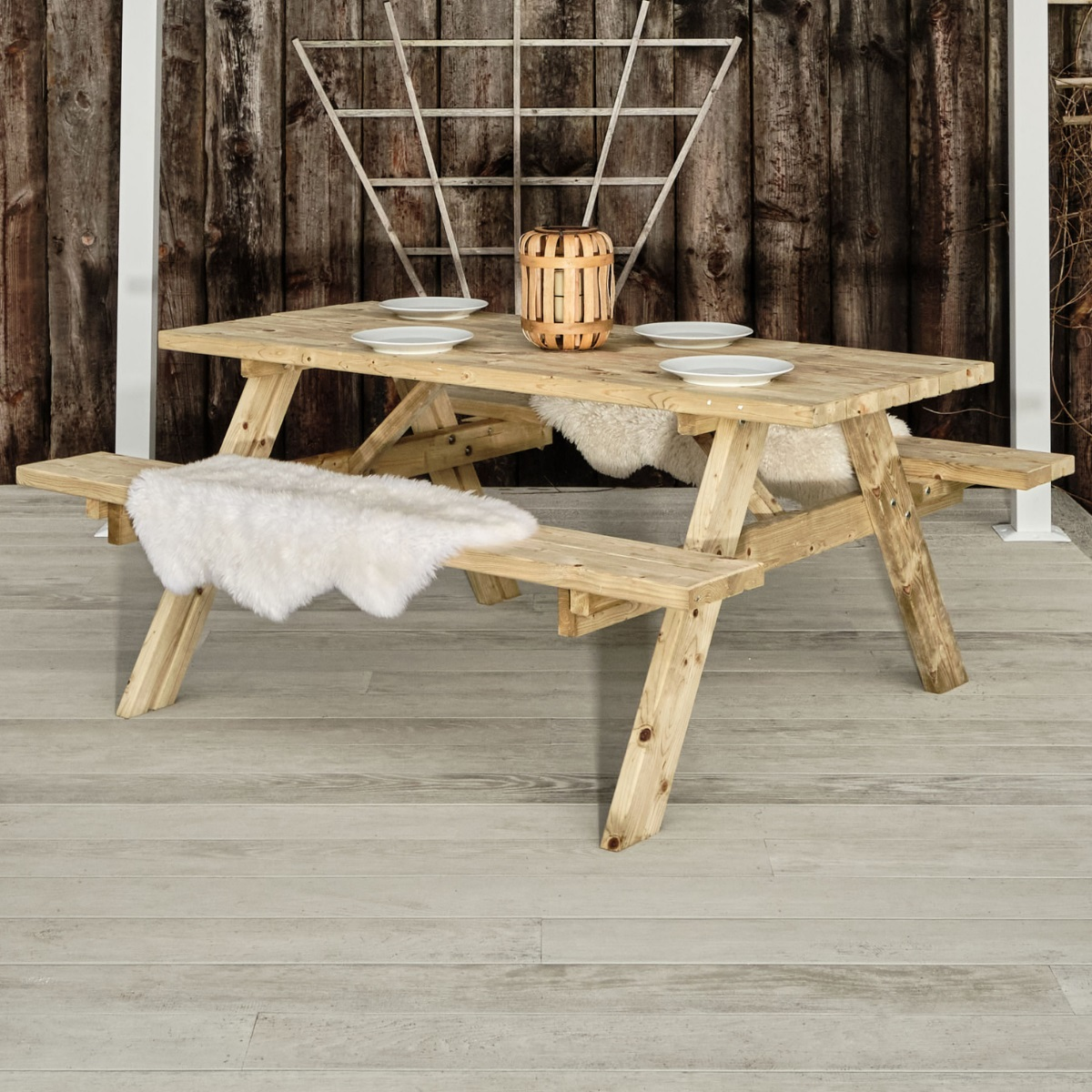 A wooden A frame picnic table seating up to 8 people on a deck
