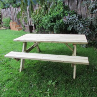 A wooden a frame picnic table on a lawn
