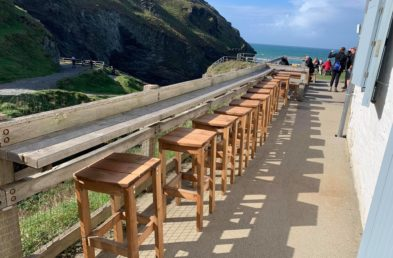 Solidly built wooden bar stools located at the outdoor cafe, Tintagel Castle