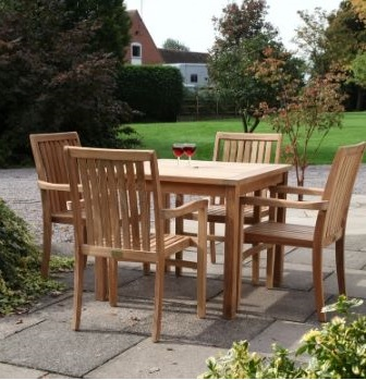 Teak 4 seater square table and 4 armchairs in a pub garden
