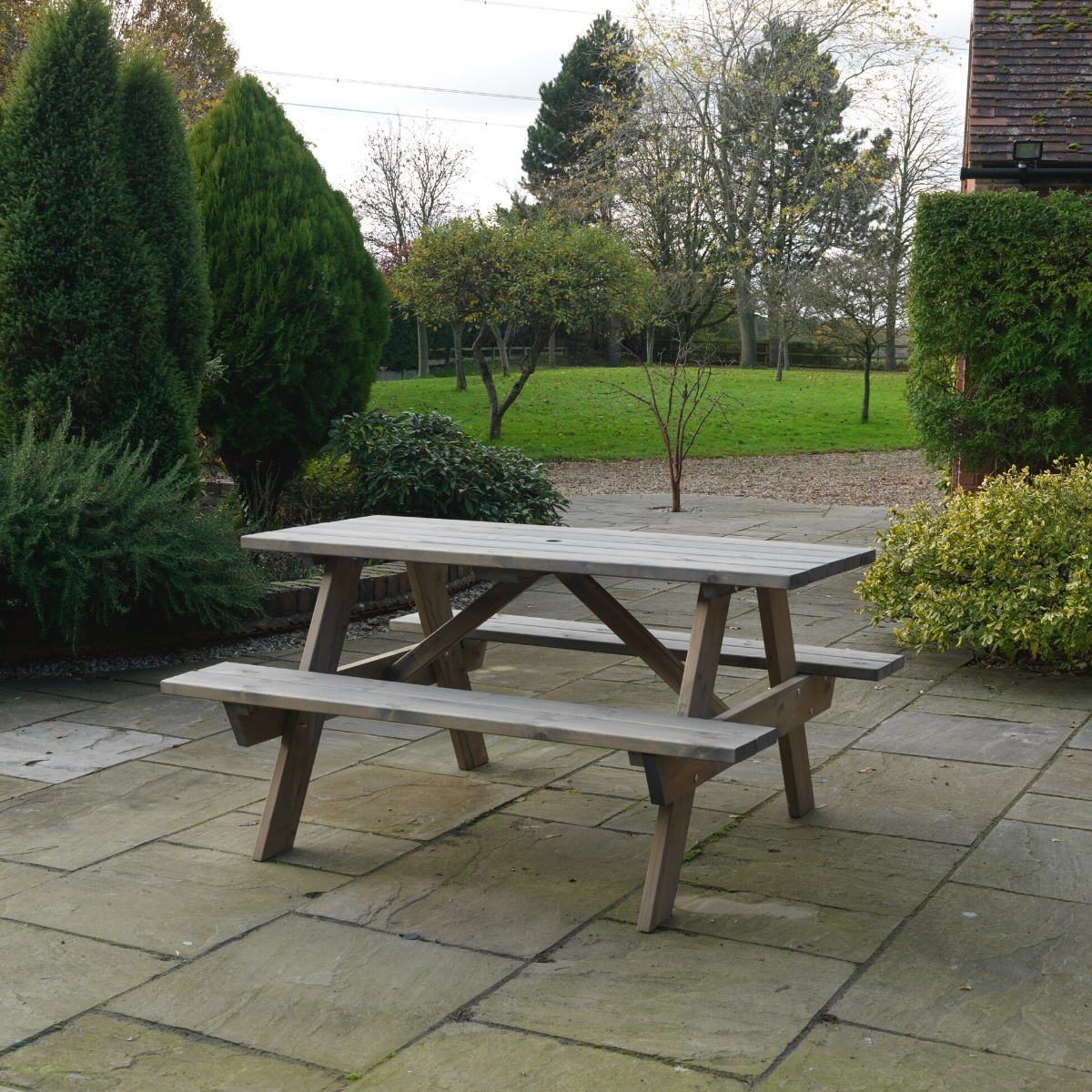 A grey painted wooden A-Frame Picnic table located on a patio