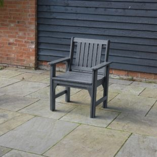 A recycled plastic dining armchair located on a patio