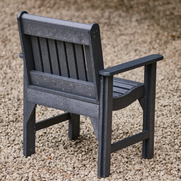 A view of the back of a recycled plastic carver dining chair