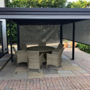 A luxury grey metal gazebo located on a patio