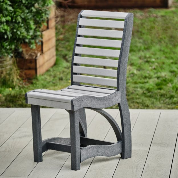 A tall backed recycled plastic outdoor dining chair in two tone grey on a deck