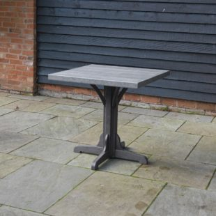 A two tone grey, recycled plastic square table located on a patio