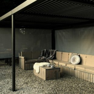 A luxury rectangular grey metal gazebo with an L shaped wooden sofa and cushions underneath