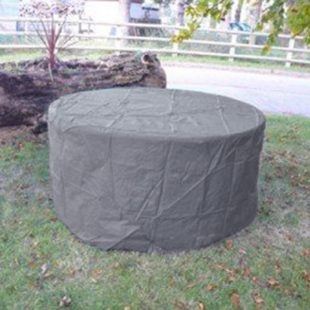 A round outdoor table covered with a UPVC weather cover located on grass