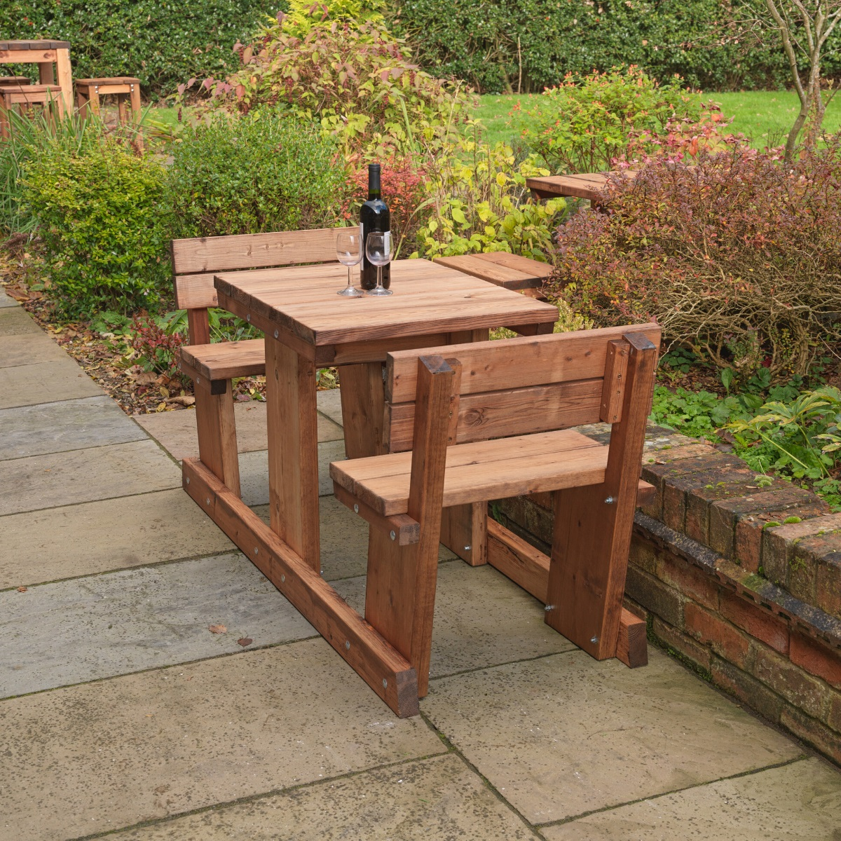 A Wooden 2 seater picnic table on a patio