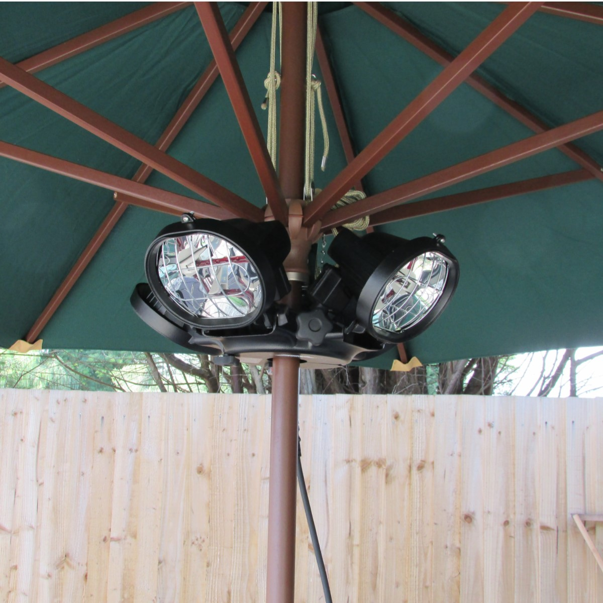 An electric lamp patio heater that can be fixed underneath a parasol to warm diners at outdoor tables in hospitality venues
