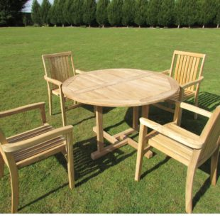 A round teak outdoor table and 4 chairs around it on a lawn