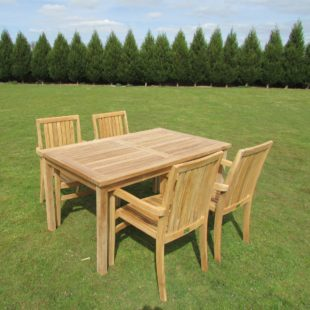 A rectangular garden dining table and 4 matching chairs arranged around it located on a lawn