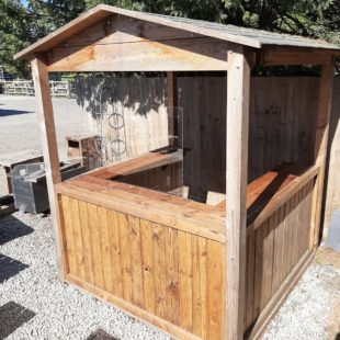 A wooden cabin with half open sides to work as an outdoor servery for pubs, hotels and other catering outlets