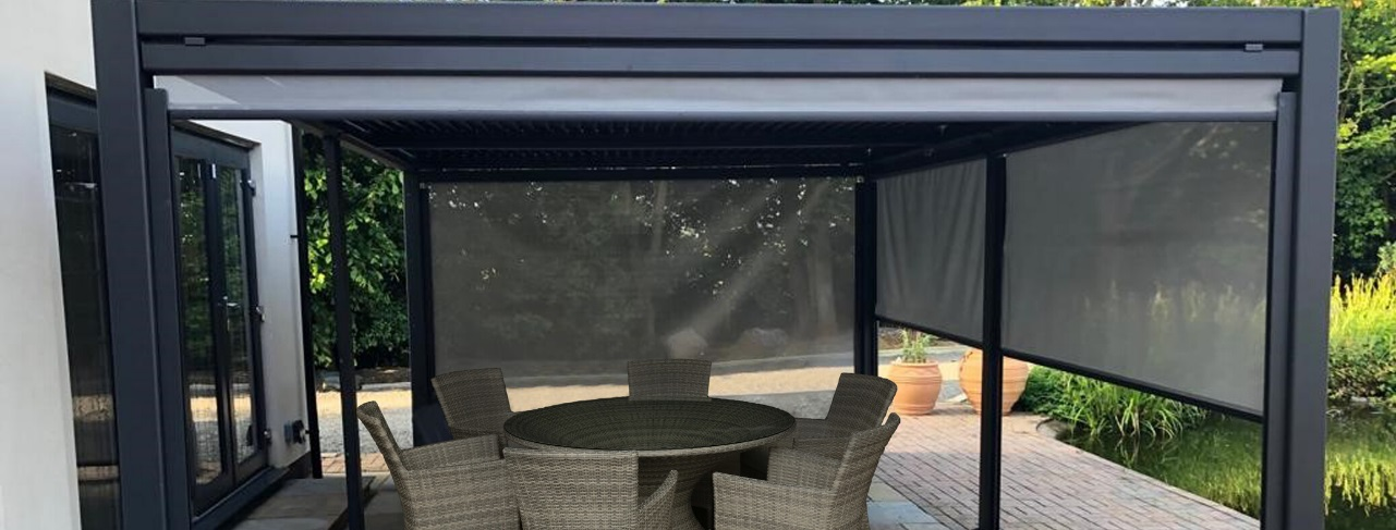 A grey metal gazebo constructed on a patio with a dining table and chairs beneath it