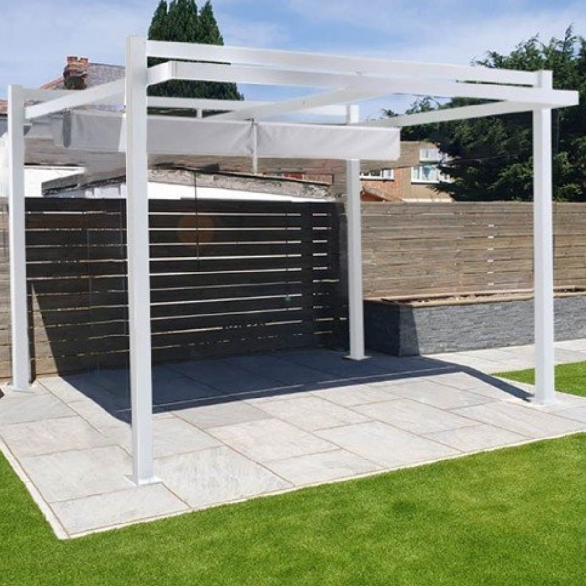 A square white metal gazebo with a retractable canvas roof