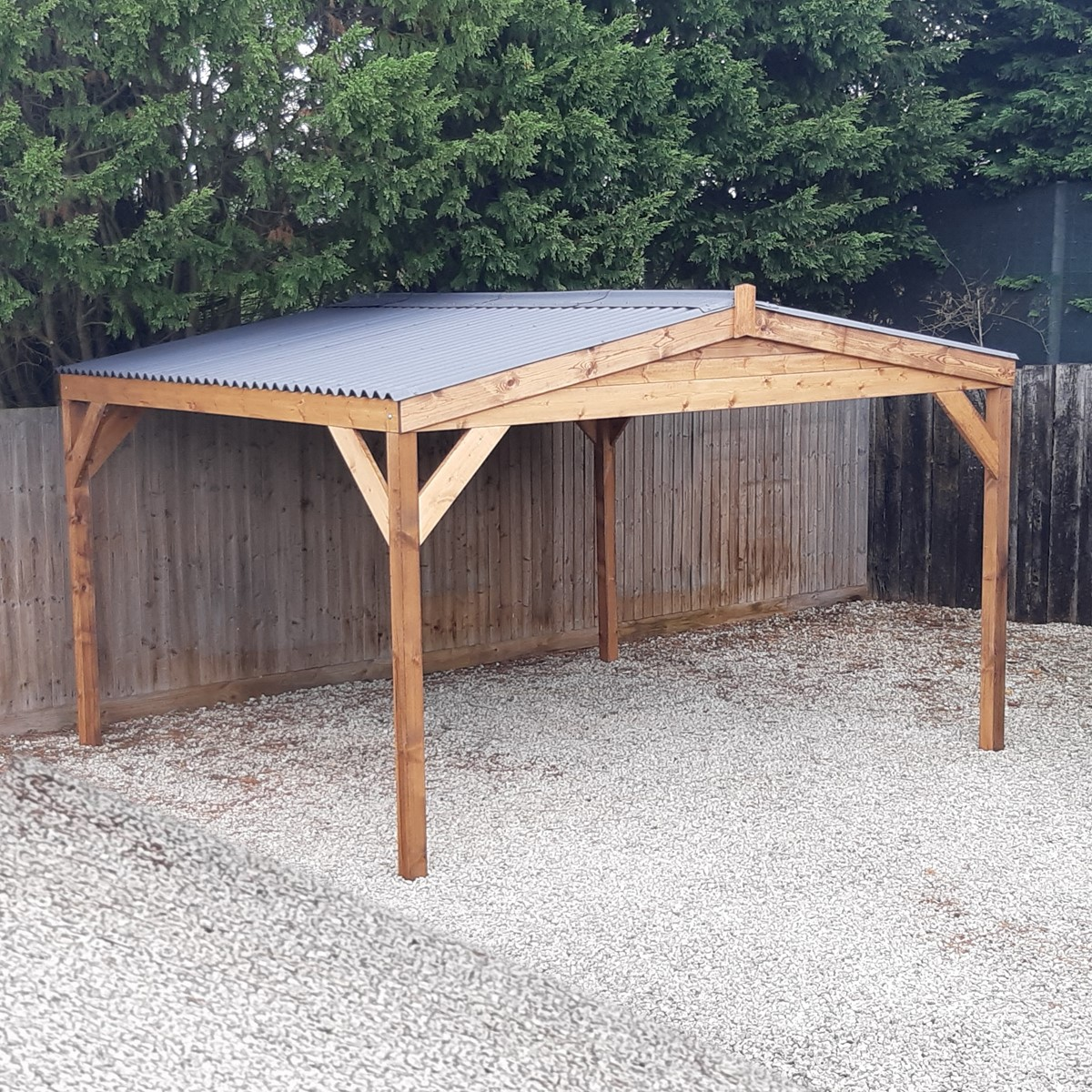A rectangular wooden gazebo with grey roof