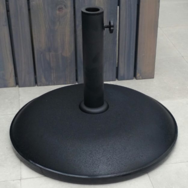 A 25kg parasol base with a round black base and screw adjuster to hold pole in place
