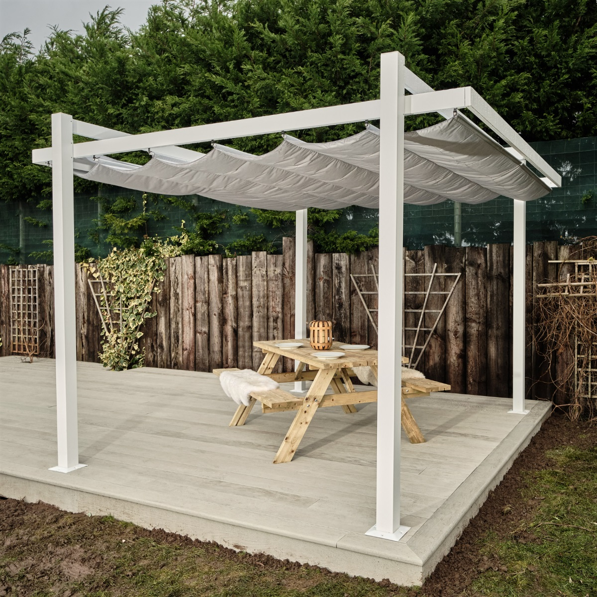 A white metal square gazebo with a concertina canvas roof that is retractable