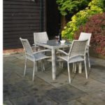 3 images of outdoor furniture, a round 8 seater picnic table, a square grey rattan table and chairs and a square teak dining table and chairs