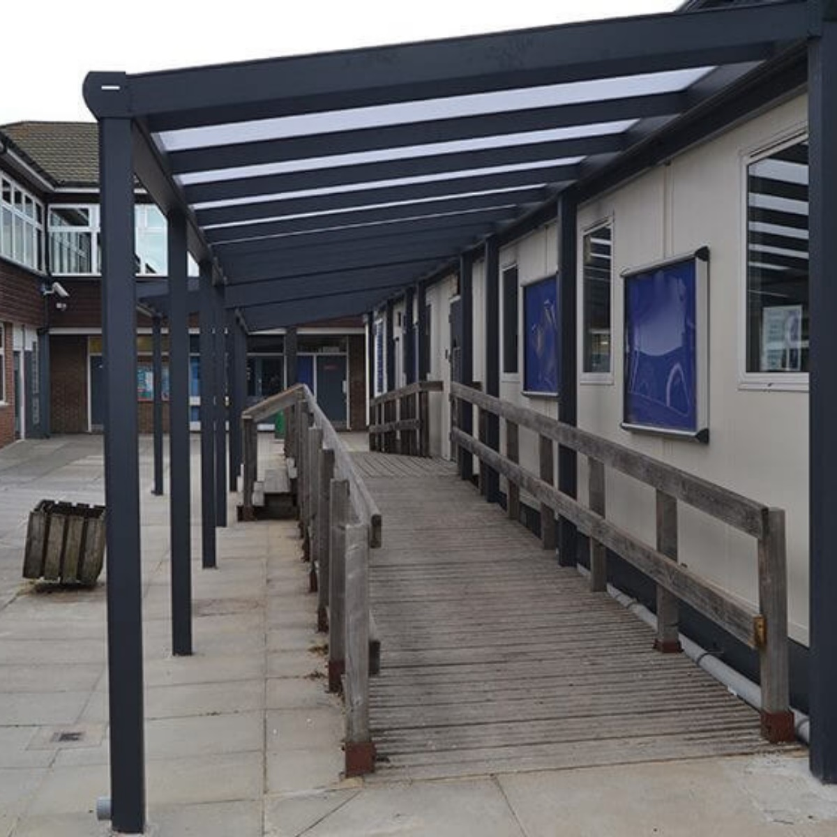 A metal framed covered walk way at a school
