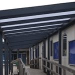 A metal framed covered walkway at a school