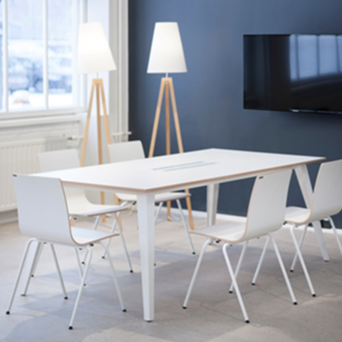 A rectangular table and 5 chairs made from antimicrobial material