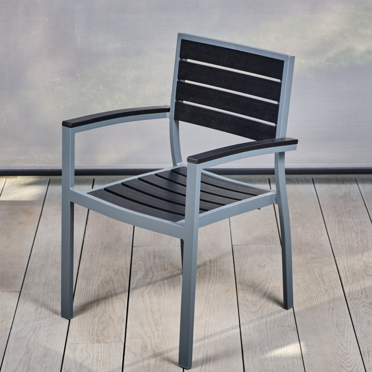 A black slatted plastic and grey aluminium outdoor dining chair