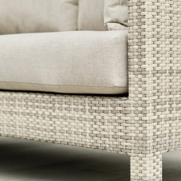 A close up of the texture of the cream grey rattan weave and cream cushion on the miami range outdoor sofa