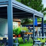 A luxury metal gazebo in a pub garden