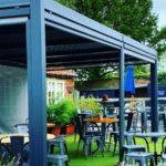 A luxury metal gazebo in a pub garden