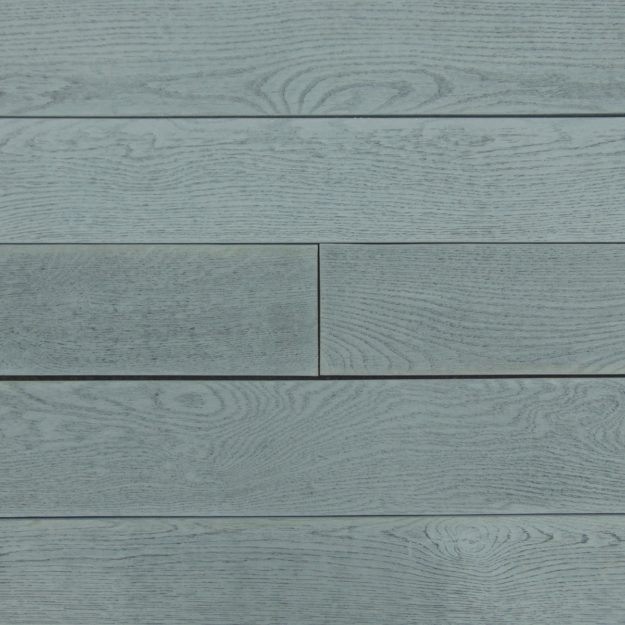 A colour sample square of dark grey wood effect Millboard decking