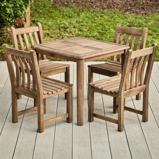 A square hardwood outdoor table and 4 chairs set on a grey wood effect deck