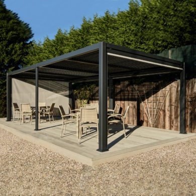 A dark grey metal gazebo with a flat slatted roof on a garden deck with rattan dining furniture underneath