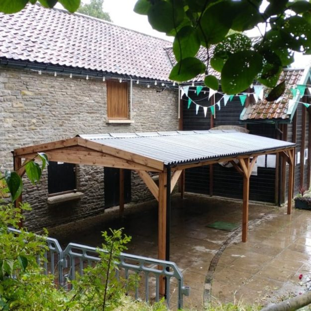A large rectangular Wooden gazebo 7m long with an apex waterpoof roof on a patio at the Shady Oak Pub