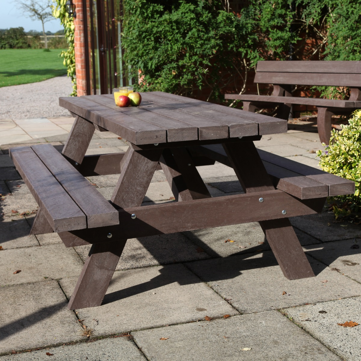 A brown recycled plastic A frame picnic table on a patio