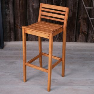 A hard wood outdoor bar chair with a seat back on a deck