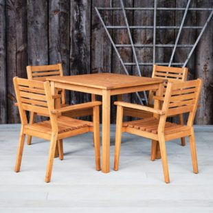 A Robinia Hardwood Outdoor Square Dining Table and 4 chairs set on a deck